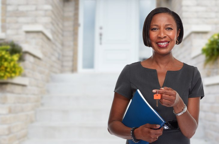 African-American realtor woman with key