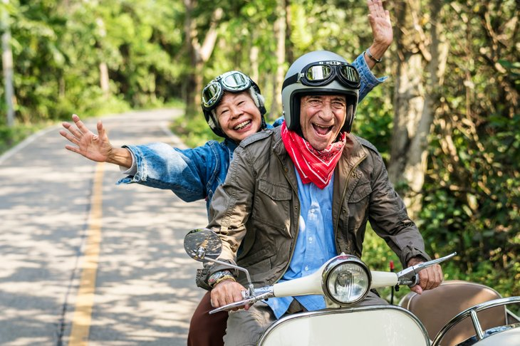 By Rawpixel.com Royalty-free stock photo ID: 1110917186 Senior couple riding a classic scooter - Image