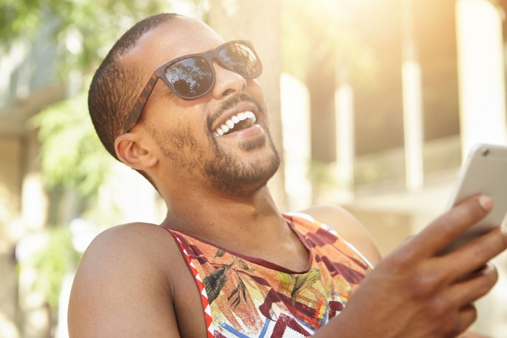 Man laughing on smartphone