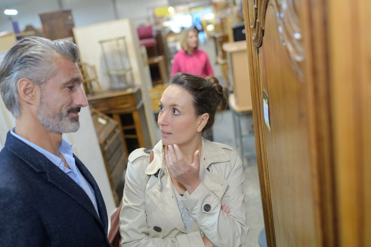 couple shopping for furniture in a secondhand store