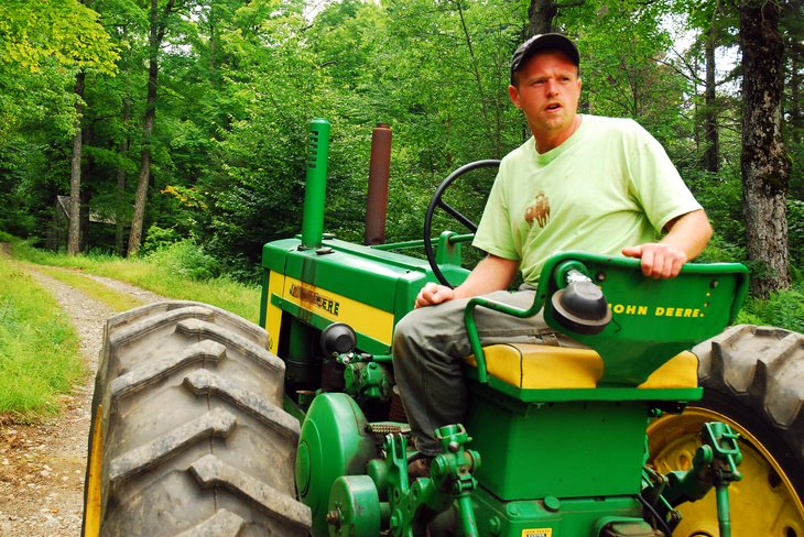 Man riding a tractor in Wilmington, Vermont