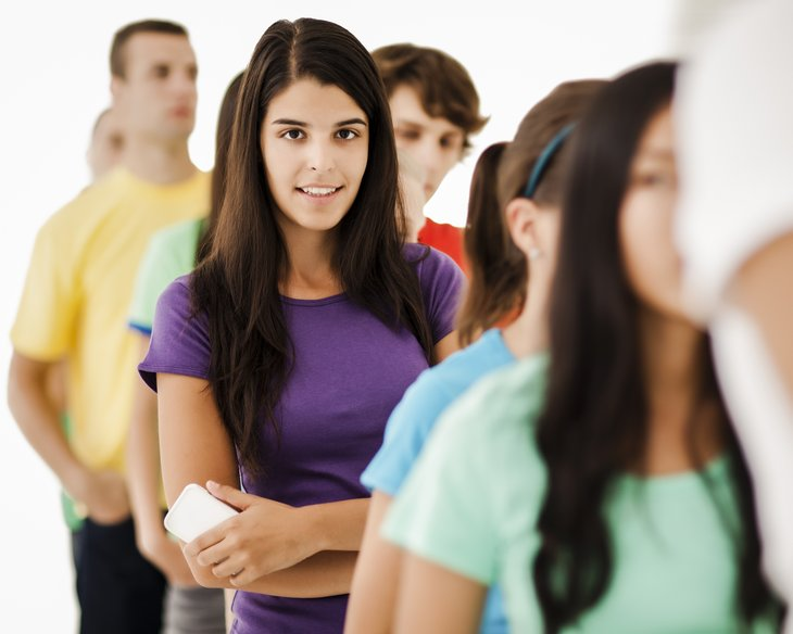 Young woman waiting in line