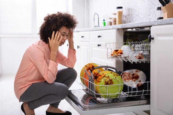 A woman on the phone about her broken dishwasher