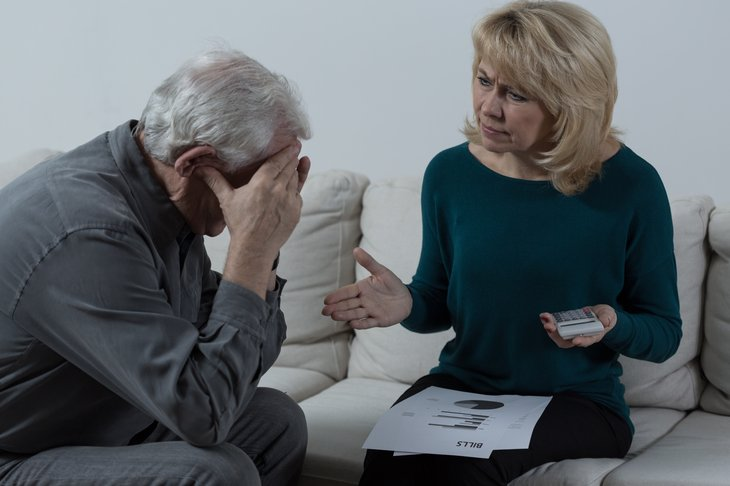 A retired couple argues about financial problems
