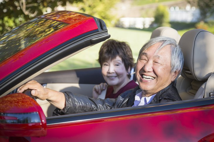 senior man woman couple asian chinese convertible red car drive ride
