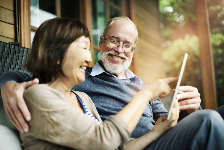 Older couple using a tablet