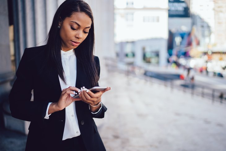 Young Black businesswoman on phone