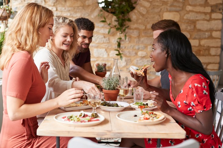 friends eating lunch at a table in a restaurant