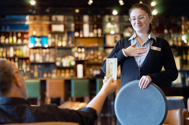 tipping restaurant woman waiter waitress tip from diner bar hotel.