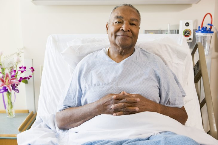 Senior man lying in a hospital bed
