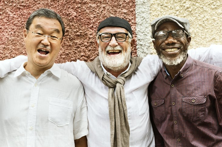 three senior men white african american asian elder older Group Of Senior Retirement Discussion