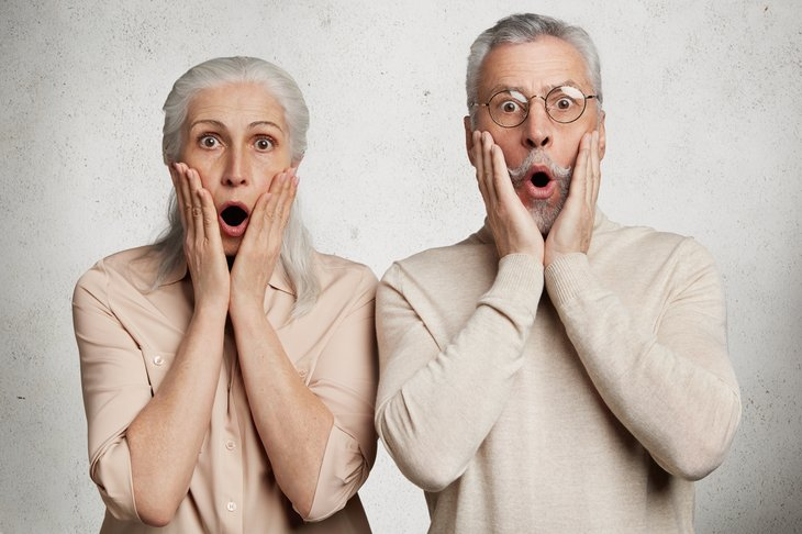 A senior couple is surprised