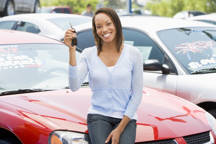 Woman holding the key to her new car