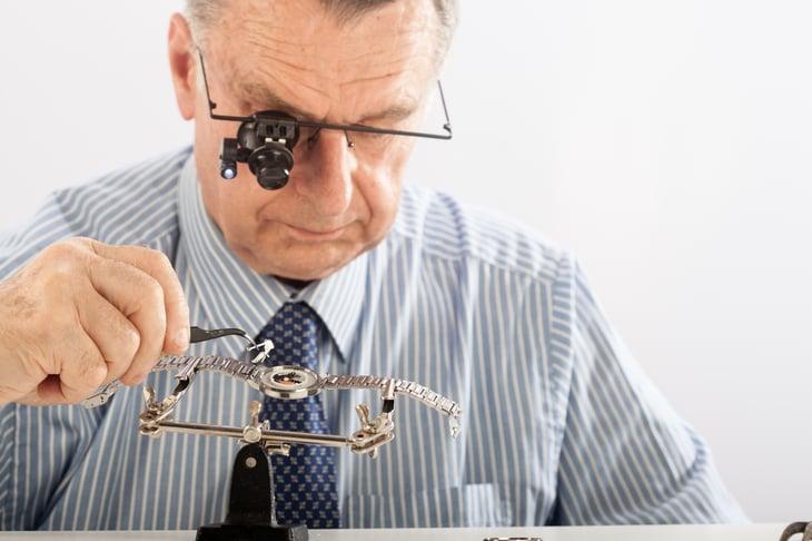 Worker repairing a watch