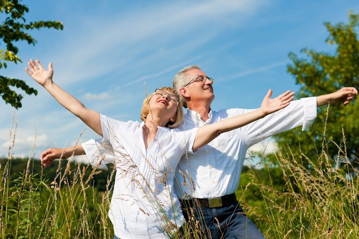 A retired couple celebrates their freedom by taking time to enjoy the sunshine and fresh air outdoors