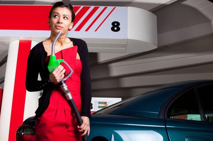 Woman at a gas pump