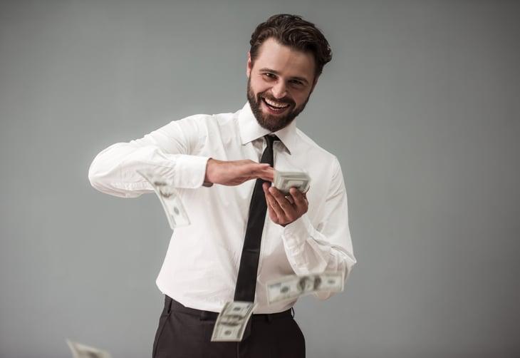 A bearded businessman makes it rain money
