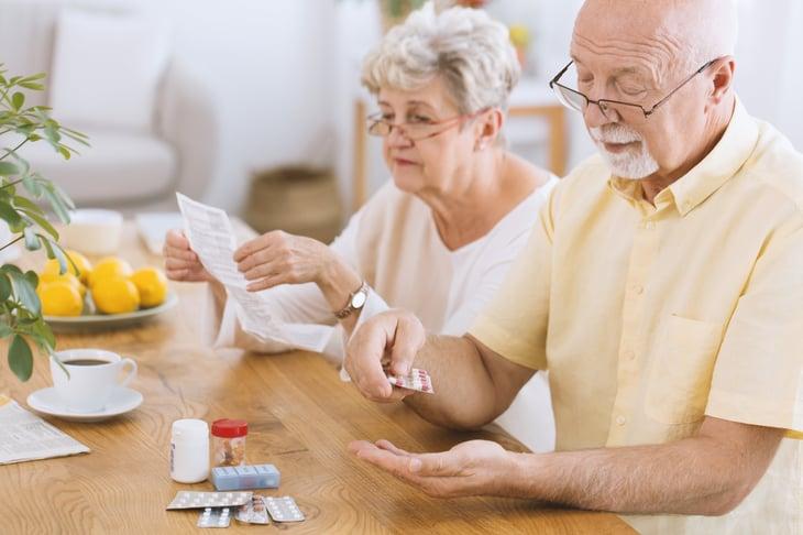 senior couple with prescription drugs