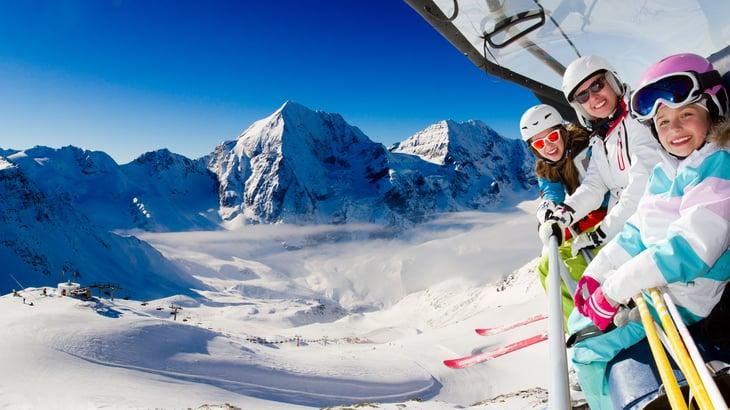 Family on a ski lift