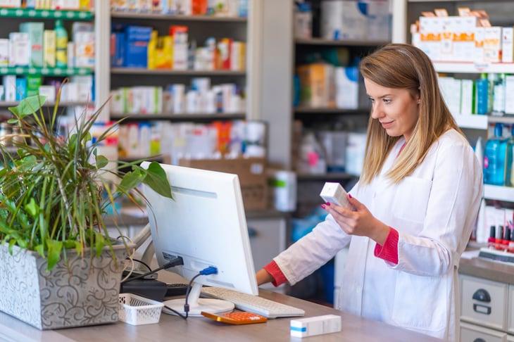Pharmacist with prescriptions
