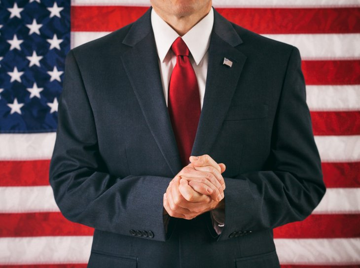Political candidate in front of an American flag