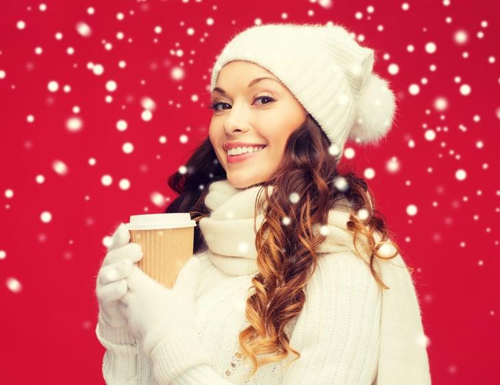 Woman in winter drinking coffee