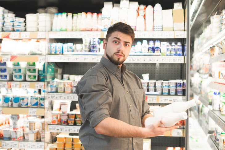 Surprised man shopping for groceries