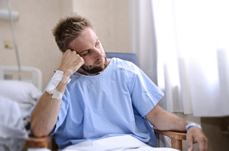 Uninsured patient in a hospital room