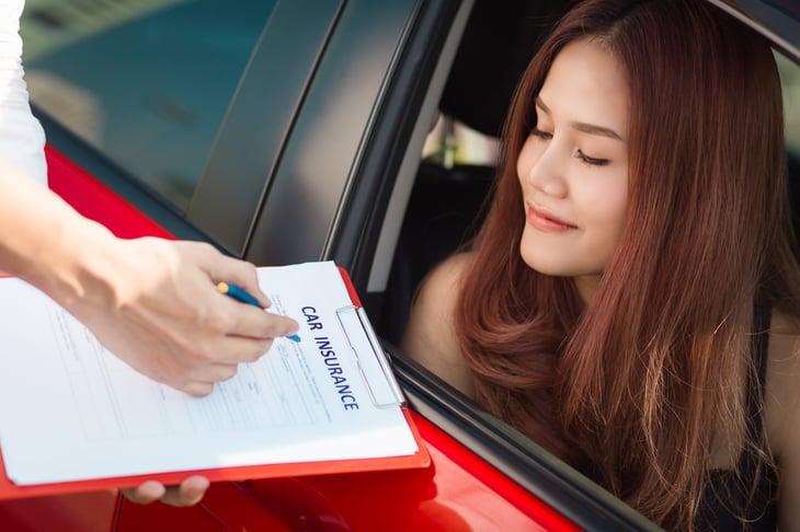 Woman ranking car insurance companies