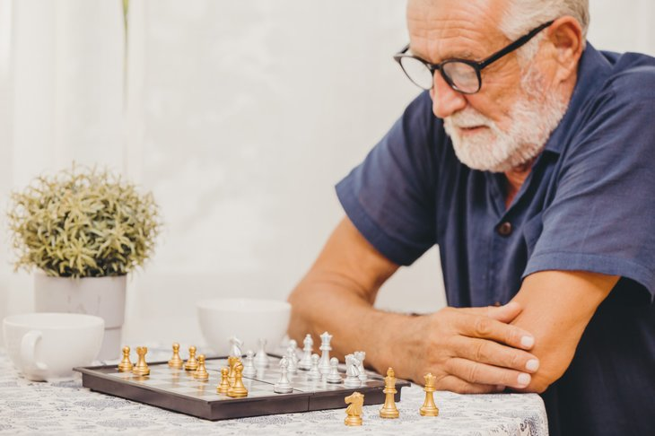 man plays board game to fight dementia