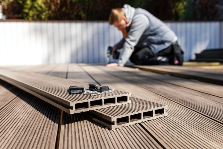 Man installing composite decking boards