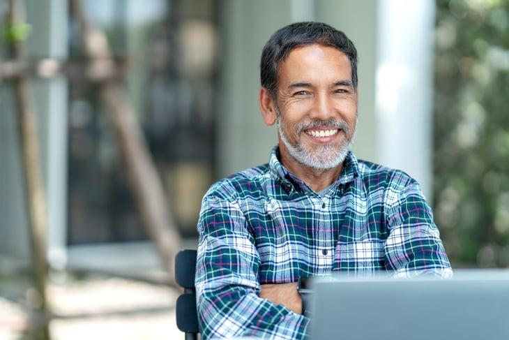 Happy senior man with laptop
