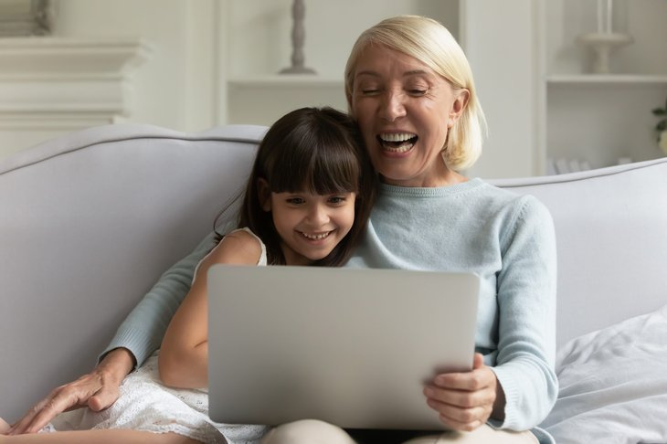 Woman and child watching video
