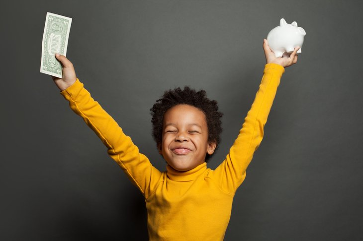 Child with money and a piggy bank