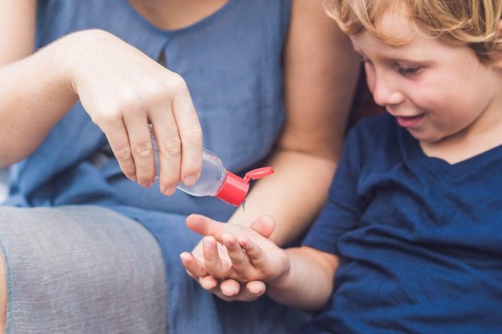 Child sanitizing hand