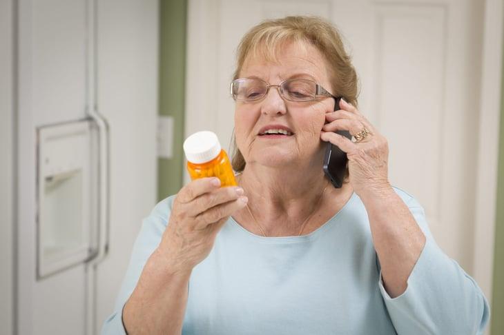 Woman with prescription drug bottle