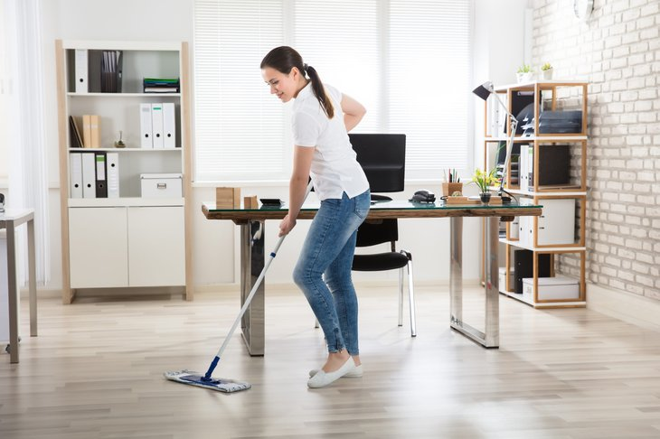 Woman mopping an office