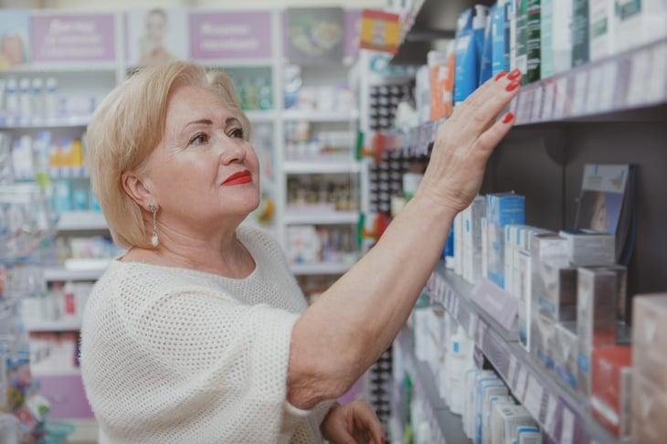 Senior woman shopping at drugstore