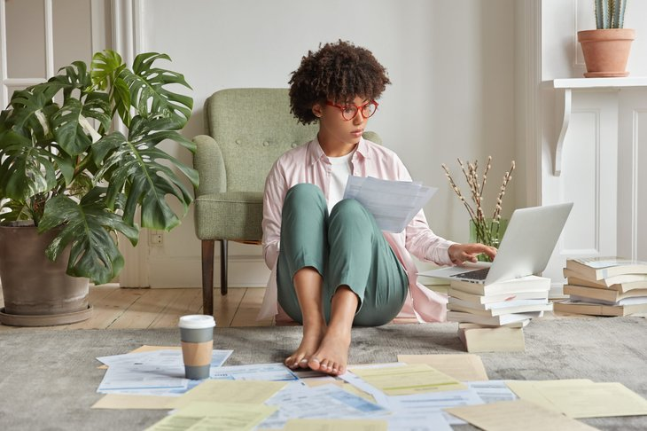 woman with tax returns and supporting documents