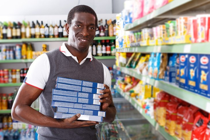 man buying food for a stockpile