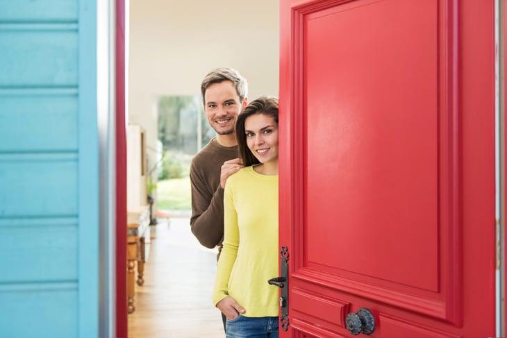 Couple opening their front door