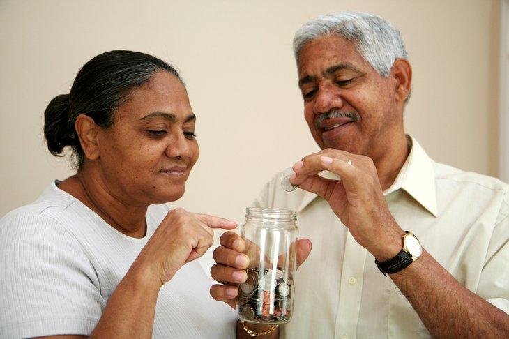 Seniors putting coins in a jar