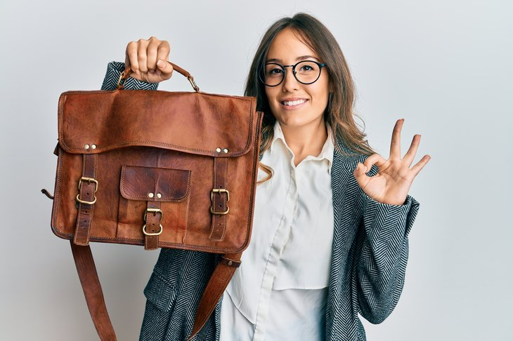 Woman holding leather bag