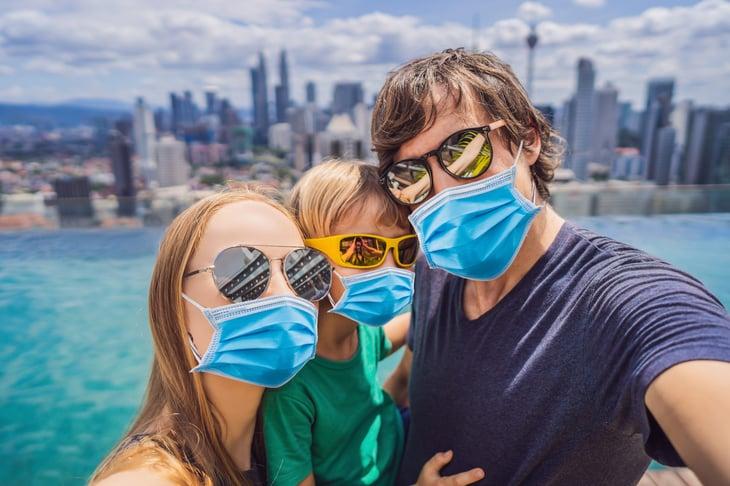 family posing for a coronavirus selfie in the city