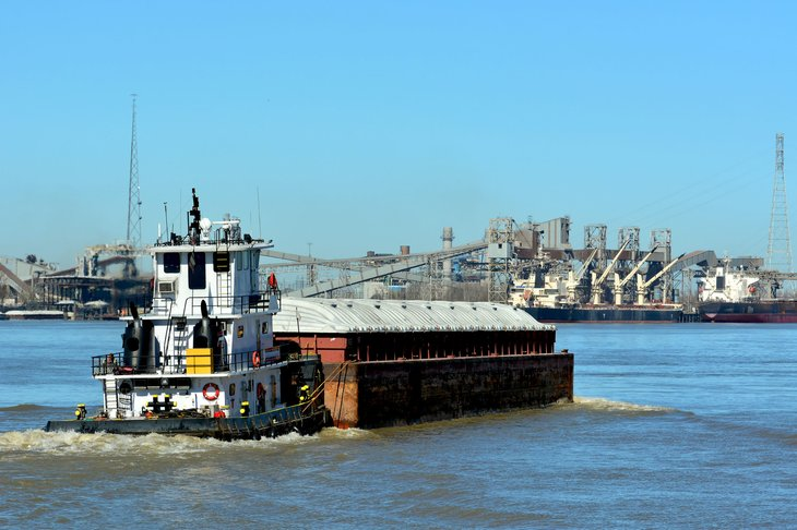 tugboat and barge. mississippi river at new orleans.