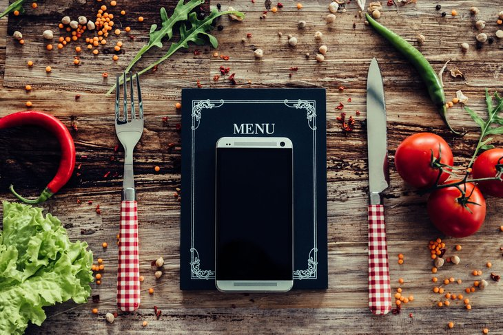 Using a smartphone to look up online menus for restaurants
