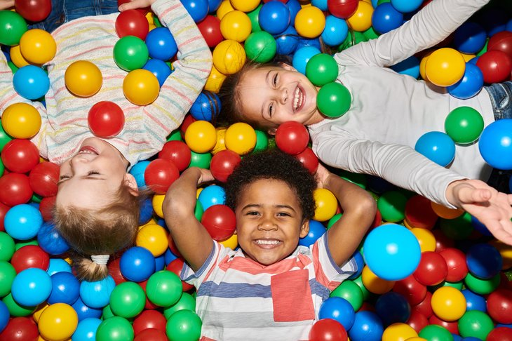 Children playing in a colorful ball pit