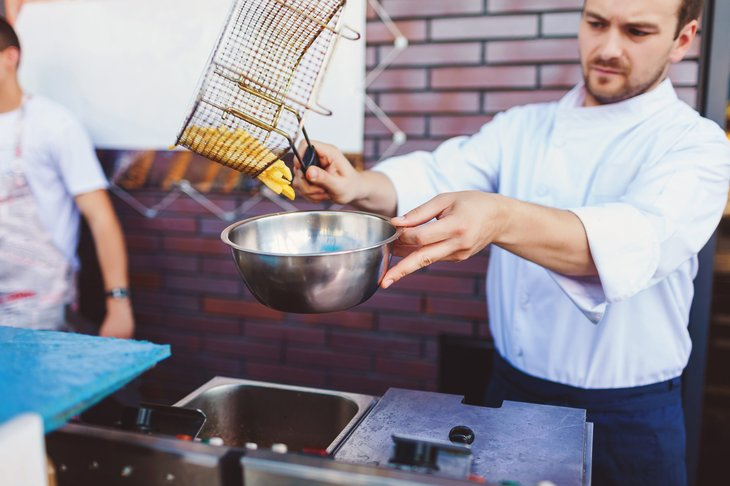restaurant chef cooking french fries outdoors