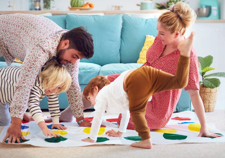 family playing twister home fun