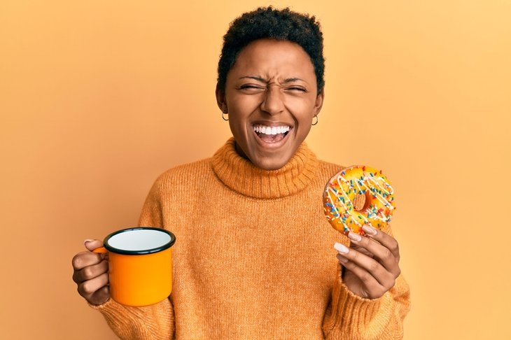 Woman with a doughnut and coffee